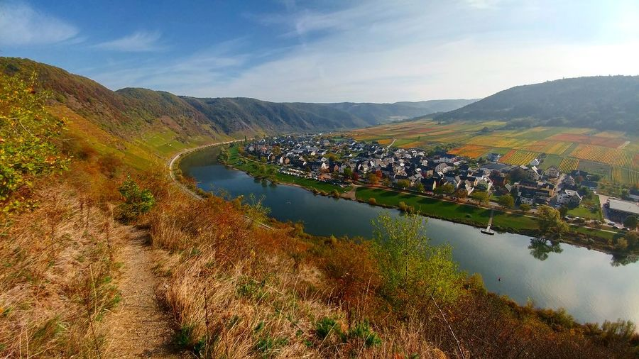 Scenic view of river mosel and mountains against sky