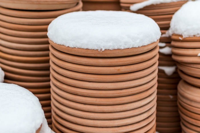 earthenware flowerpots outdoors in snow winter Winter Clay Close-up Cold Temperature Day Earthenware Flowerpot Flowerpots No People Outdoors Pottery Snow Stack Winter