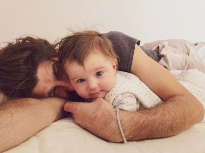 father and baby waking up in the morning Toddler  Nap Fatherhood Moments Cuddling Parenthood Daddy Morning Waking Up Childhood Child Baby Young Relaxation Indoors  Real People Innocence Portrait Bed Lying Down Babyhood Resting Togetherness Cute Looking At Camera