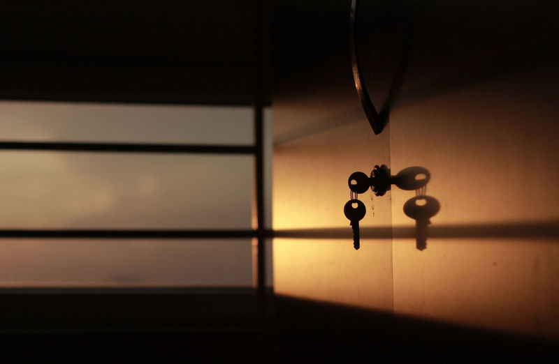 Close-Up Of Key On Locker Against Window
