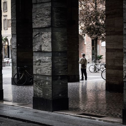 EyeEm Architecture Full Length Architectural Column Built Structure Real People One Person Men Standing Photography EyeEm Selects Light And Shadow Architecture Building Exterior Day One Man Only Only Men City Adult Adults Only People