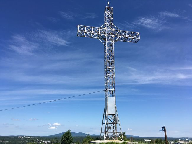 Cross on a sunny day. Sky Nature Low Angle View No People Cloud - Sky Religion Cross Architecture Tall - High Built Structure Outdoors Lighting Equipment Metal Day