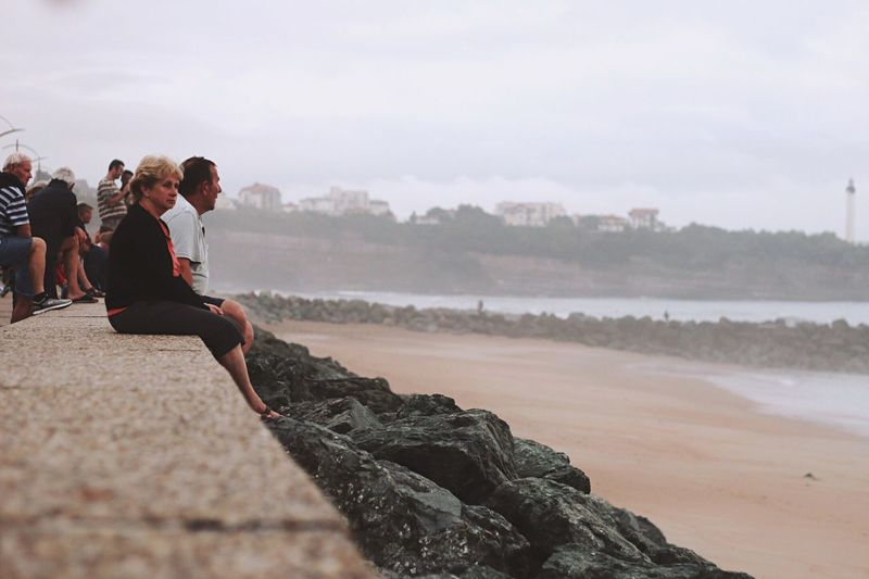 People And Places Beach Waves Waves, Ocean, Nature Wind Nature Nature_collection Grey Sky Sky Sky And Clouds Clouds People Person Sitting France Sea Ocean Ocean View
