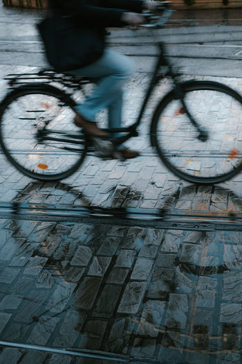 Gent Bicycle Transportation Mode Of Transportation City Day No People Motion Outdoors Blurred Motion Building Exterior on the move Wheel Street Stationary Rain Rainy Days Winter Bike Streetphotography Street Photography Gent Belgium Cold Temperature EyeEmNewHere EyeEm Best Shots