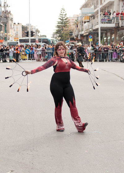 Nahariyya, Israel, March 10, 2017 : Participant at the traditional annual сarnival parade - juggler shows her art for the viewers on the street in Nahariyya, Israel Adloyada Adult Beauty Carnival Celebration Colorful Costume Culture Day Decoration Dressed Entertainment Festival Fun Happy Israel Masquerade Nahariyya Outdoors Parade Party People Style Traditional Travel