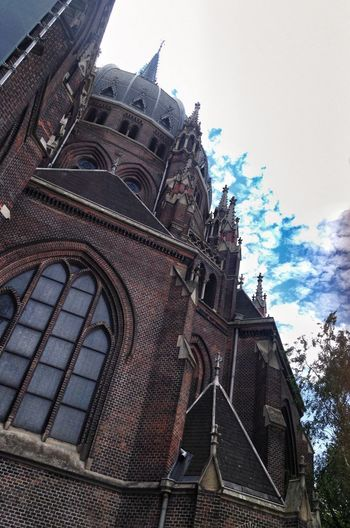 Church. Popular Photos Cloud - Sky Bricks Window Cloud Clouds And Sky Sky Church Architecture Built Structure Sky Low Angle View Building Exterior Building Nature Religion No People Place Of Worship Belief Day History The Past Spirituality Travel Destinations Tourism City Outdoors Spire