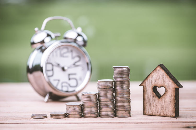 Finance Time Coin Investment Savings Clock Wealth Stack Business Alarm Clock Currency Number Focus On Foreground Table Wood - Material No People Finance And Economy Close-up Still Life Silver Colored Clock Face Economy Making Money