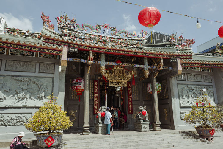 Shot at Thien Hau Temple, Saigon, Vietnam. Architectural Column Architecture Building Exterior Built Structure Day Men One Person Outdoors People Place Of Worship Real People Sky Spirituality Travel Destinations Women
