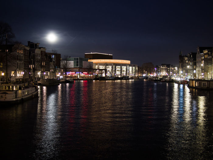 Building Exterior Night Architecture Reflection Built Structure City Water Illuminated Sky Waterfront No People Building Nature Transportation River Nautical Vessel Outdoors City Life Mode Of Transportation Cityscape Nightlife