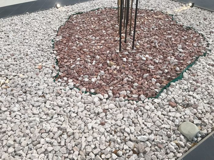 High angle view of stones on pebbles
