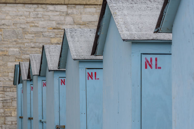 View of beach huts in a row