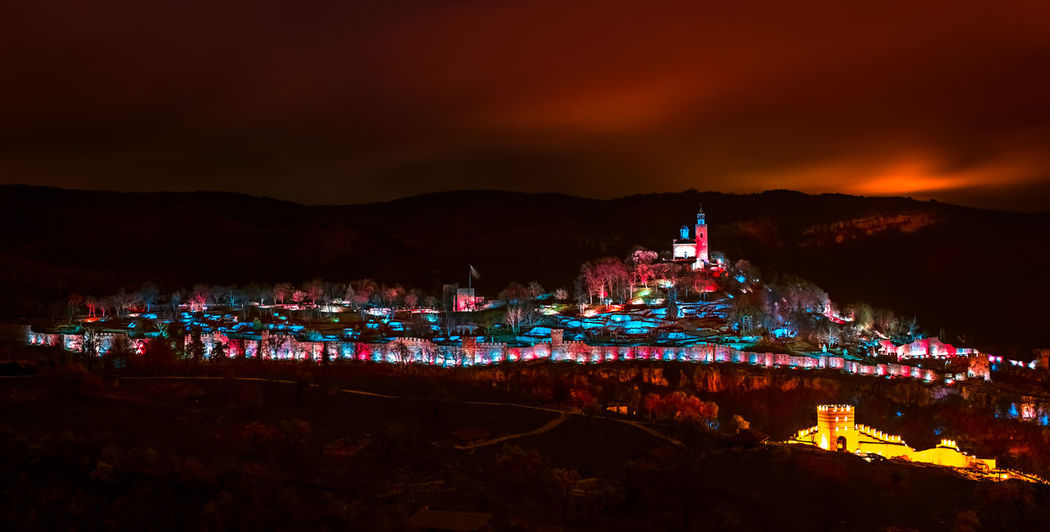 Show of lights under the red sky. Tsarevets fortress, Veliko Tarnovo city, Bulgaria VelikoTarnovo Fortress Fortress Wall Light Light Show Nightphotography Night Photography Long Exposure Red Sky Red Sky At Sunset Bulgaria Tsarevets Illuminated Architecture Mountain Night Building Exterior Built Structure Sky City Nature Building Water Land Cityscape No People Outdoors Travel Destinations Beauty In Nature Mountain Range Residential District