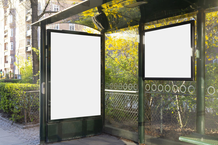 Blank billboard in a bus stop Architecture No People Tree Communication Blank Advertisement Window Plant Built Structure Sign Day Billboard Copy Space Nature Frame Entrance Empty Outdoors Placard Message Marketing Mock Up Mockup Advertising