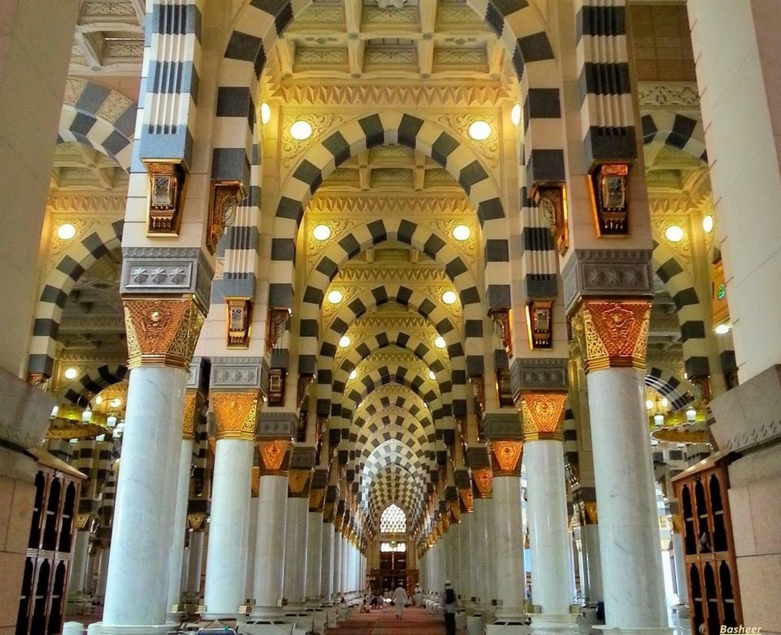illuminated, architecture, built structure, building exterior, lighting equipment, night, indoors, travel destinations, decoration, in a row, ceiling, famous place, place of worship, low angle view, religion, city, incidental people, building, tourism, ornate