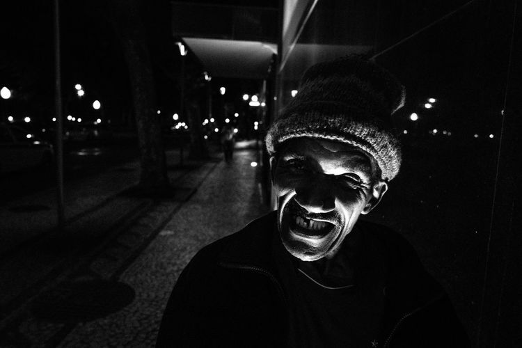 Portrait of smiling man at night