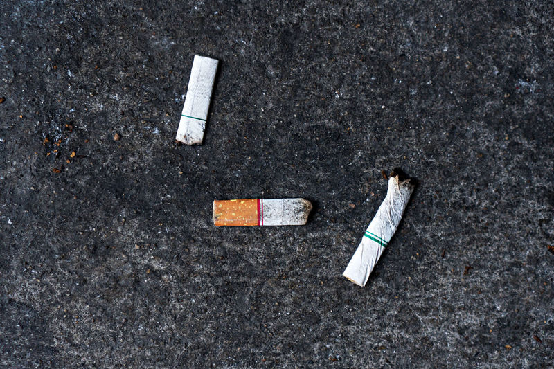 cigarette stub No People Directly Above Group Of Objects Copy Space Dirt Indoors  Road Asphalt Day High Angle View Unhygienic Cigarette Butt Cigarette  Cigarette Butt Cigarette Lighter Cigarette Time Cigarette Butts Cigarette Stub Smoke Smoking Smoke Stack Smoking Issues Health Healthy Healthcare And Medicine Cigarette  Communication City Medium Group Of Objects Sign Lung Death Burning Burn Habit Cancer CancerSucks Cancerawareness Cancer Survivor Cancer - Illness