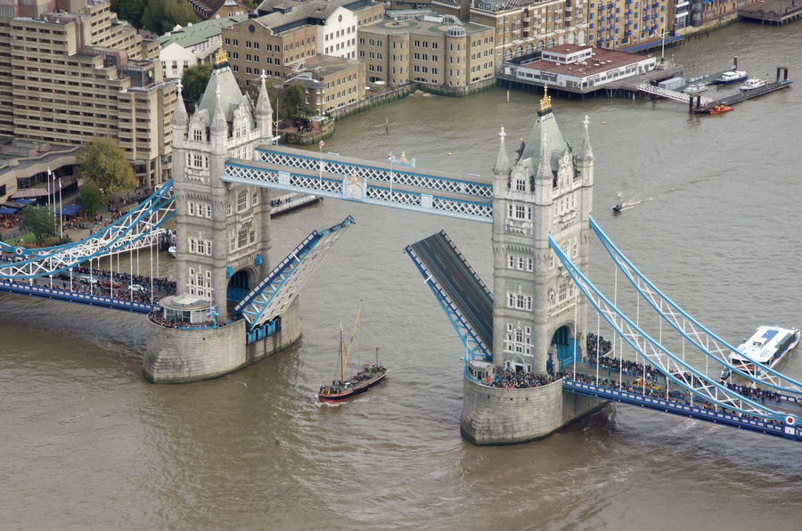 Tower Bridge opened to allow the passage of a Thames Barge Architecture Bridge - Man Made Structure Building Exterior Built Structure City Connection Day Mode Of Transport Nautical Vessel Outdoors People Thames Barge Thames River Tower Bridge  Tower Bridge Open Transportation Travel Destinations Water