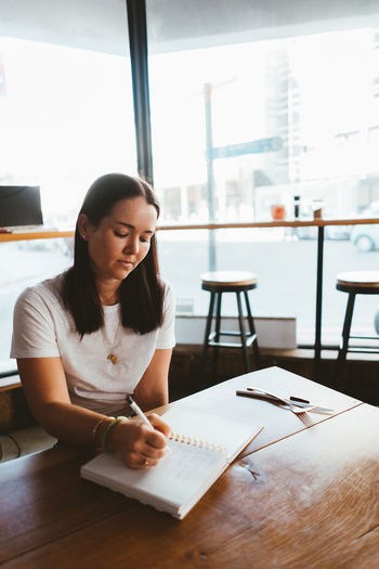 Woman Writing Cafe Ideas Notes Restaurant