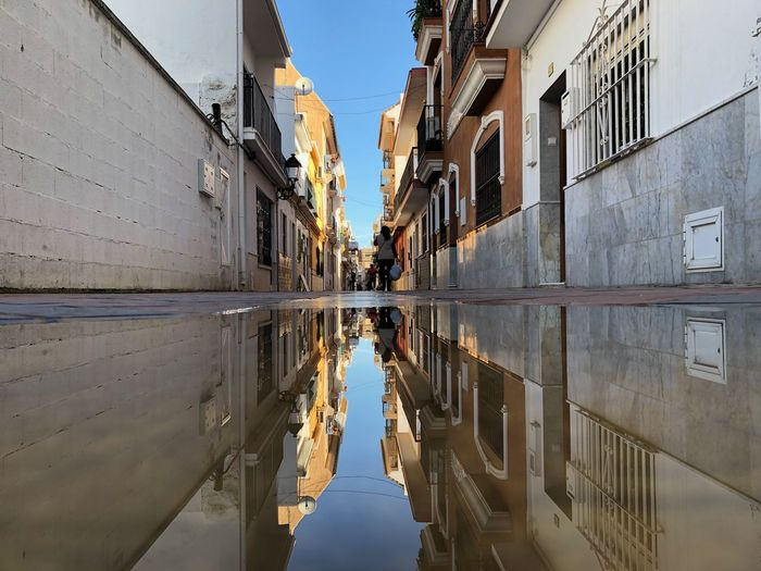 Tricks with a small puddle of water Puddle Reflections Architecture Building Exterior Built Structure Building Reflection Water City Day Canal Residential District Nature Sky Diminishing Perspective Waterfront Outdoors Window The Way Forward Direction Men Alley