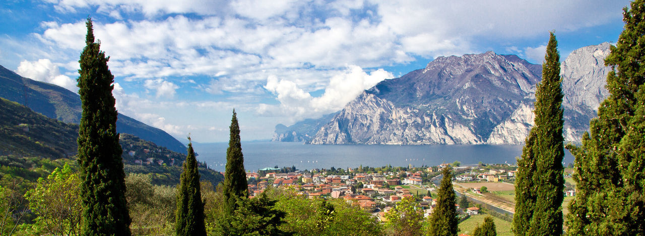 View on Torbole, Lake Garda, Italy Gardasee Green Lake Garda Panorama Travel Traveling Vacations View City Cycling Destination Garda Idyllic Italy Lake Landscape Mountain Nature Sea Sky Spring Springtime Torbole Town Windsurfing