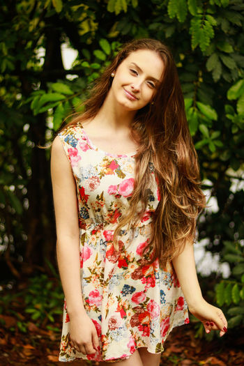 Beautiful Woman Day Focus On Foreground Front View Leisure Activity Lifestyles Long Hair Nature One Person Outdoors Real People Smiling Standing Tree Young Adult Young Women
