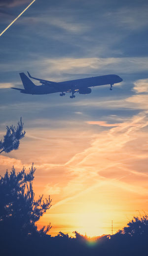 Colors Sunset_collection Air Vehicle Airplane Airport Cloud - Sky Evening Sky Flying Low Angle View Mid-air No People Plain Scenics Silhouette Sky Sunset Transportation