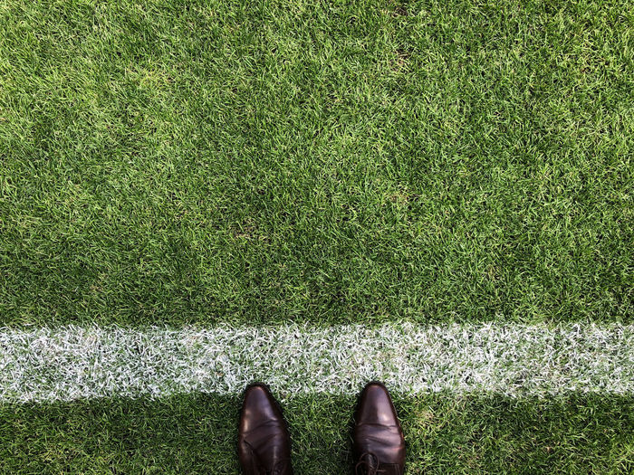 Football Stadium Body Part Day Field Grass Green Color Growth High Angle View Human Body Part Human Foot Human Leg Human Limb Land Lifestyles Low Section Nature One Person Outdoors Personal Perspective Plant Real People Sacoo Shoe Standing