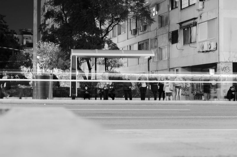 bus station people with no face Architecture Building Exterior Built Structure City Tree Plant Street Window Day Motion Blurred Motion Incidental People Nature Reflection Outdoors Building Transportation Selective Focus Glass - Material Surface Level Blurry People Black And White Waiting Difrent People