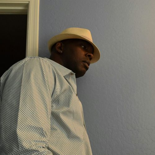 Low Angle View Of Man Wearing Hat By Wall At Home
