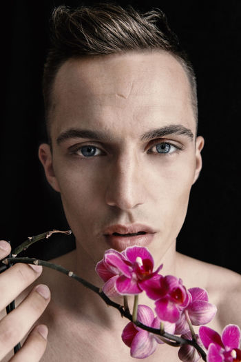 Bartek in Berlin – This is Masculinity Berlin Lifestyle Stylish This Is Masculinity Adult Beauty Black Background Boy Close-up Day Flower Fragility Freshness Guy Headshot Indoors  Leasure Activity Model One Person Pink Color Portrait Real People Romantic Sky Studio Shot Young Adult
