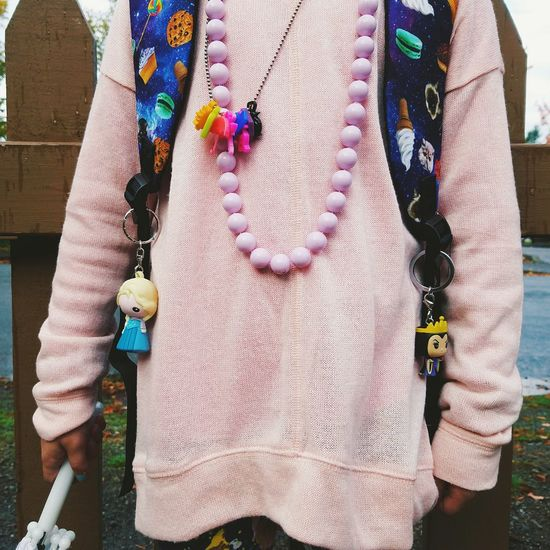 Art And Craft Person Close-up Multi Colored Creativity Casual Clothing Wool Choice Elementary Age Childhood Lifestyles Fashion Charms Flair Necklace Millennial Pink