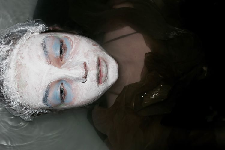 Close-Up Of Woman With Facial Mask At Beauty Spa