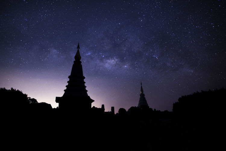 Silhouette Temple Against Star Field At Night