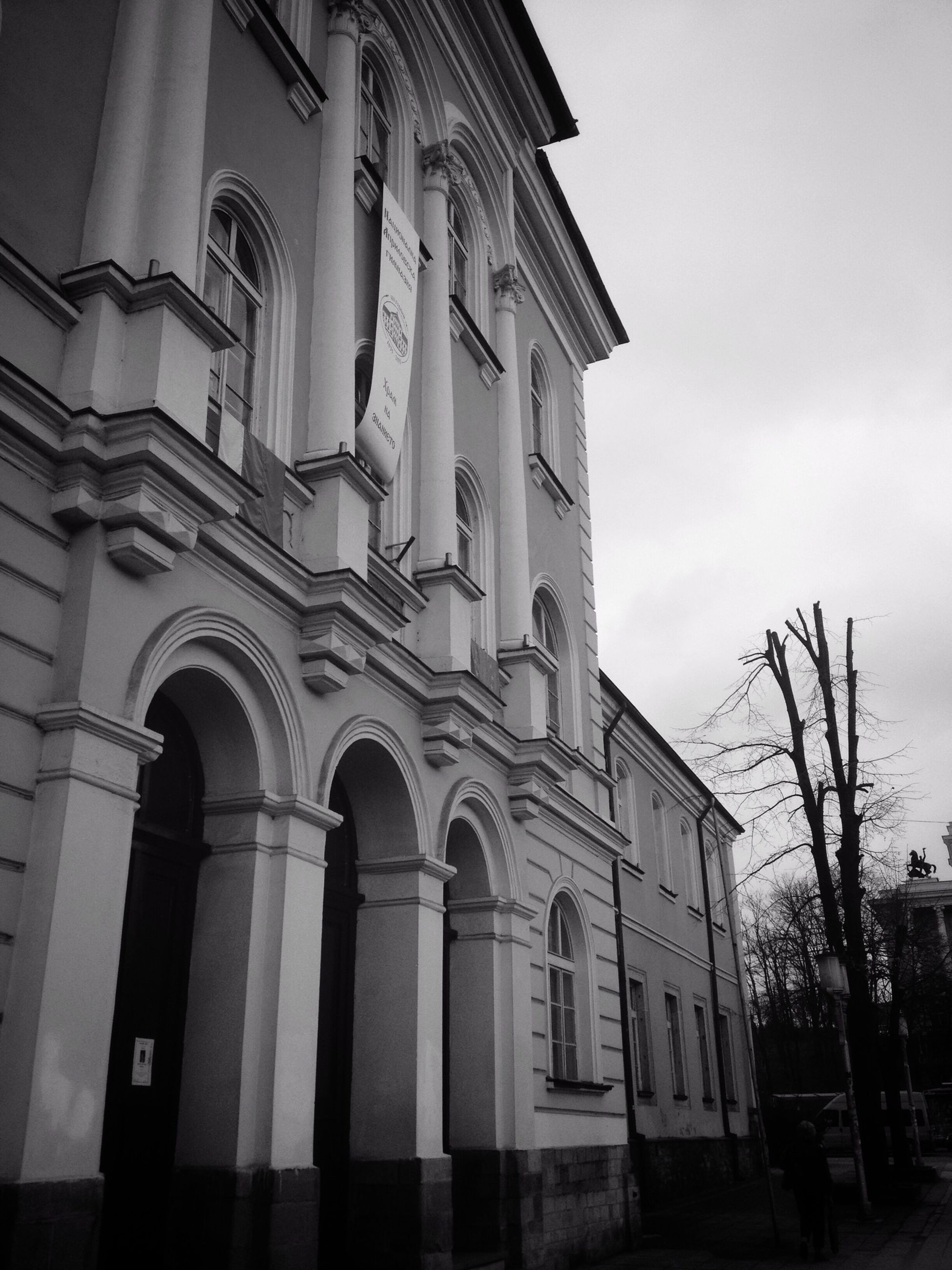 architecture, built structure, building exterior, low angle view, sky, window, arch, building, city, facade, outdoors, day, no people, street light, church, cloud - sky, history, cloud, religion, street