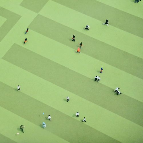 High Angle View Of Students Playing At Schoolyard