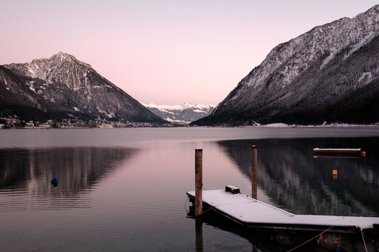 Achensee Achensee Austria Water Mountain Beauty In Nature Scenics - Nature Reflection Lake Sky Tranquil Scene Mountain Range Tranquility Idyllic Non-urban Scene Waterfront Sunset No People Nature Nautical Vessel Outdoors Wood - Material