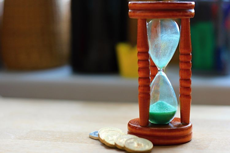 Time is the most precious thing and no money can buy it. This is the meaning of this image, with an hourglass with the empty top to show ... CarpeDiem  Composition Desk Hour Life Wood Blurred Background Close-up Coins Coins On The Table Day Focus On Foreground Glass Hourglass Indoors  Money No People Old Sand Space Table Time Time To Reflect Vintage Wood - Material