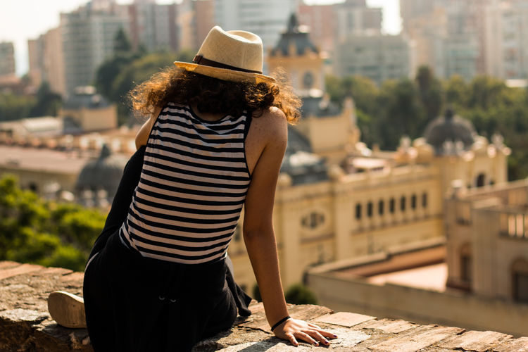 One Person City Young Women Watching Solo Dreams Malaga Panorama Girl Freedom Toplife Top Lifestyles Happiness Future Casual Clothing Hat Focus On Foreground Looking At View Joy EyeEmNewHere A New Perspective On Life