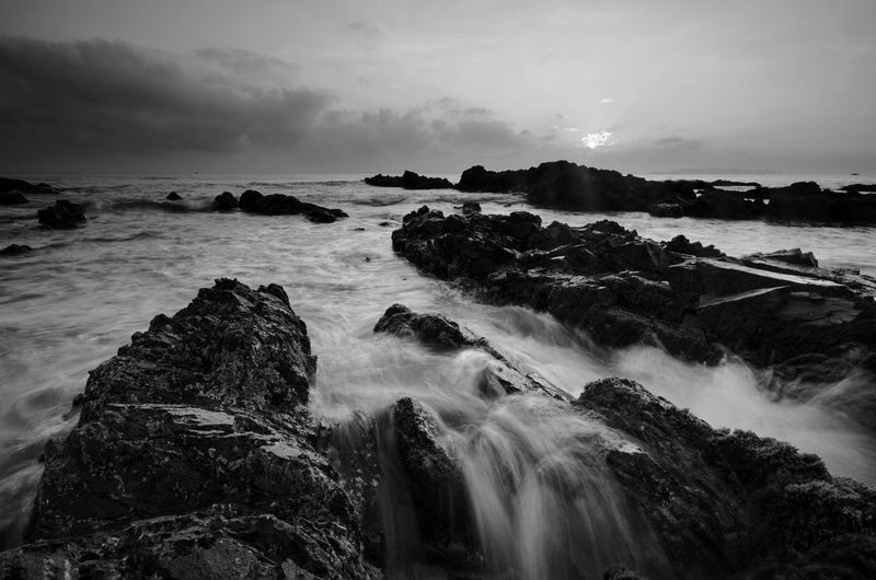 Amazing rock formations at Pandak beach, Terengganu in black and white monochrome fine art technique.  Nature composition blur soft focus noise visible due to long exposure effect. Fine Art Black And White Amazing View Amazing Black&white Fine Art Photography Black Blackandwhite Backgrounds Sunrise EyeEm Water Sea Beach Wave Sunset Beauty Rock - Object Sky Horizon Over Water Landscape Flowing Water Stream - Flowing Water Flowing Power In Nature Seascape