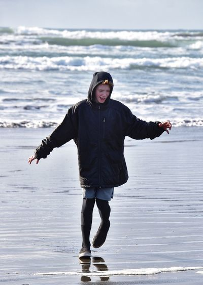 Full length portrait of man standing on beach