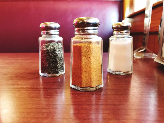 Close-up of pepper shaker on table