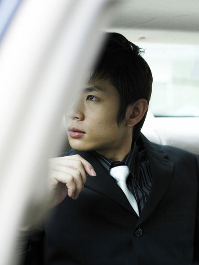 Business Business Stories In A Car Looking Out Suit Businessman Close-up Day Headshot Indoors  Lifestyles Men One Person People Real People Transportation Well-dressed Young Adult Young Men