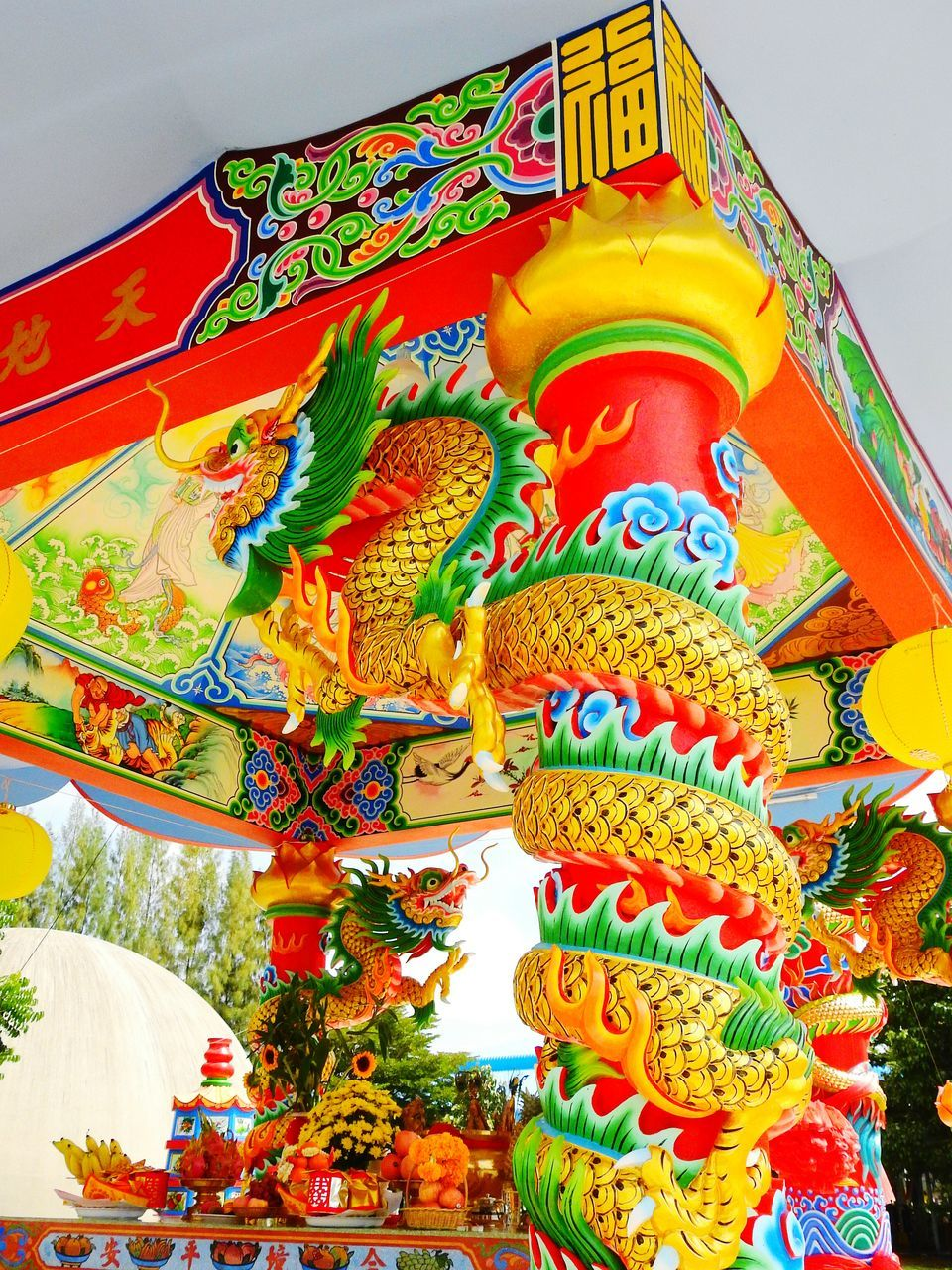 low angle view, hanging, chinese lantern, multi colored, lantern, cultures, no people, religion, day, outdoors, dragon, spirituality, place of worship, architecture, chinese dragon