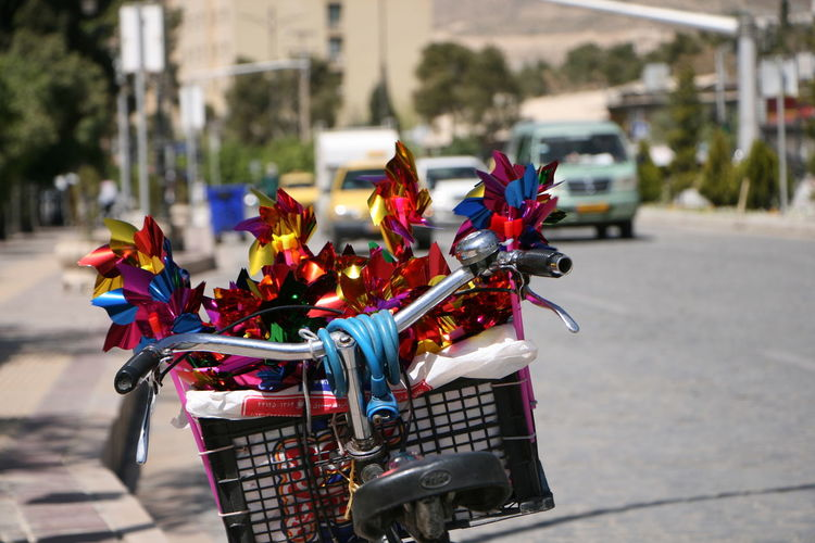 Close-up of multi colored bicycle on street