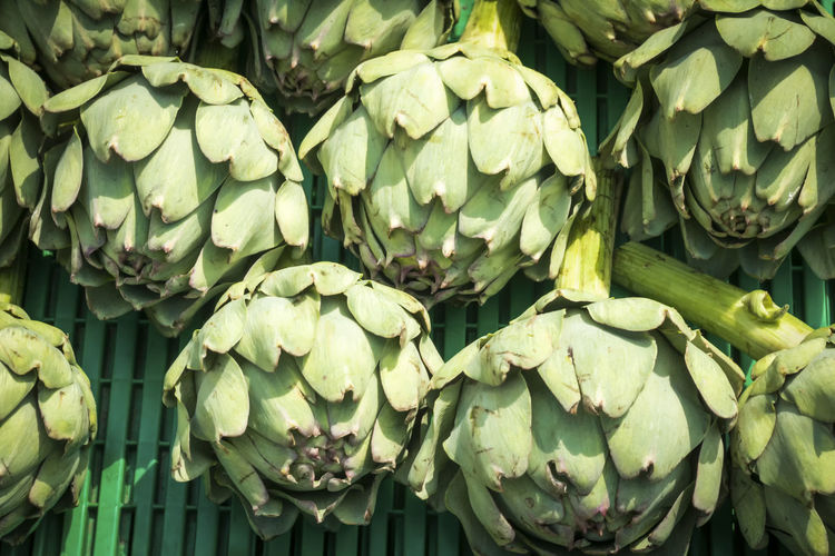 Artichokes on a market stall Artichoke Bunch Close-up Day FiveADay Food Food And Drink For Sale Freshness Green Color Growth Healthy Eating Market Nature No People Organic Outdoors Retail  Salad Stall Vegetable