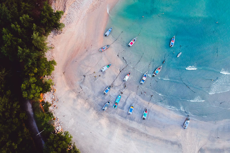 Aerial view of boats moored on beach