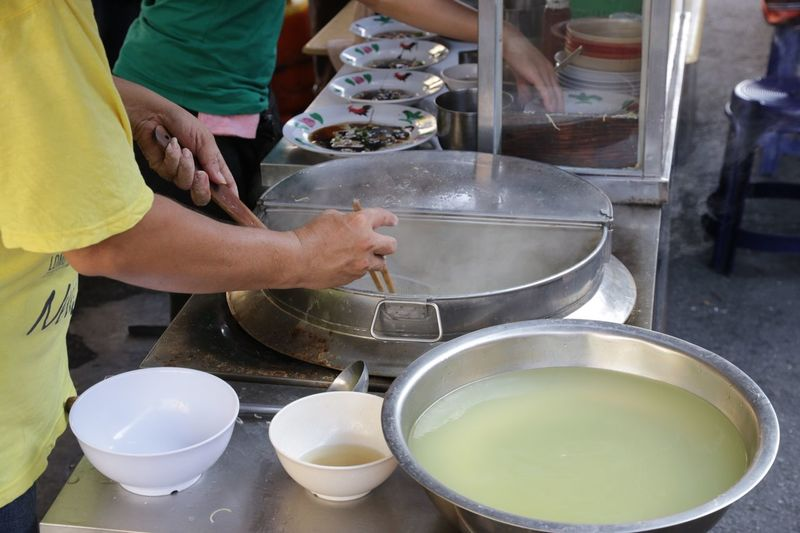 Midsection of people making food at restaurant