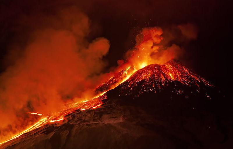 Volcano erupting at night