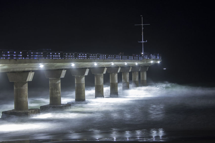 Waves and concrete. Architecture Beauty In Nature Bridge - Man Made Structure Built Structure City Connection Engineering Illuminated Jetty Motion Nature Night Ocean Outdoors Pier Sea Sky Speed Water Waterfront