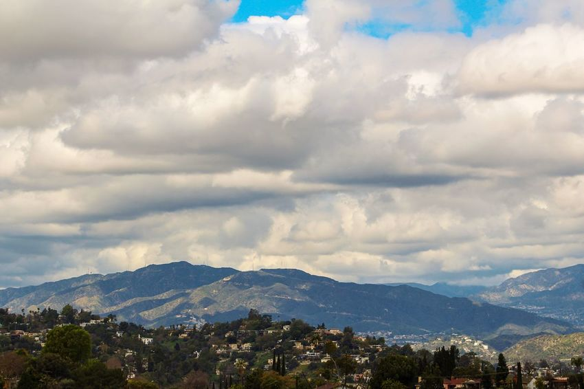 Cloud - Sky Sky Scenics Beauty In Nature Mountain Nature Landscape Outdoors Mountain Range Tranquility No People Tranquil Scene Building Exterior Day Built Structure Storm Cloud Architecture